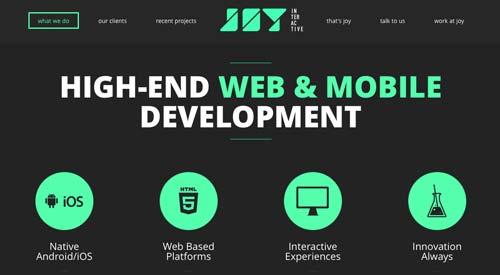Ejemplos de paginas web minimalistas con colores oscuros: Joy Interactive